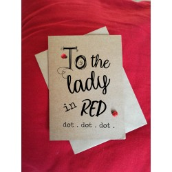 To the lady in red. dot . dot . dot .